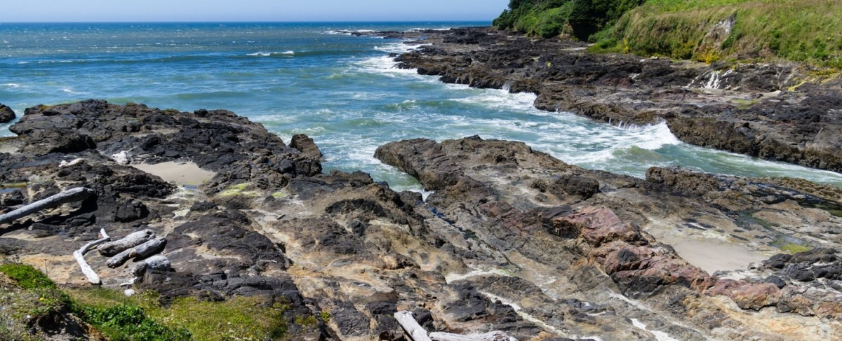 Oregon coast inlet and rocky shore.