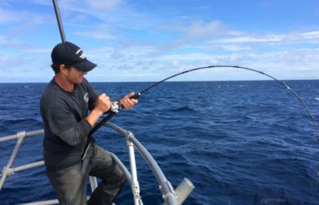 Man deep sea fishing.