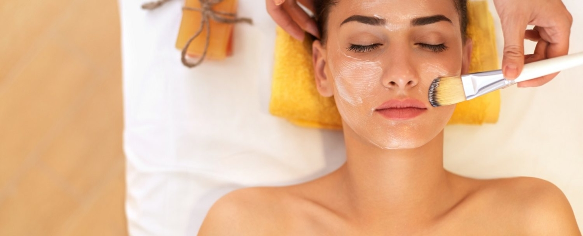 Woman getting a facial scrub.