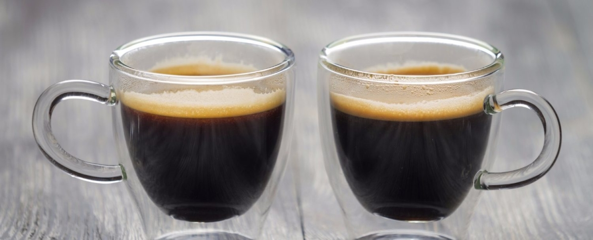 Two glass cups of coffee.