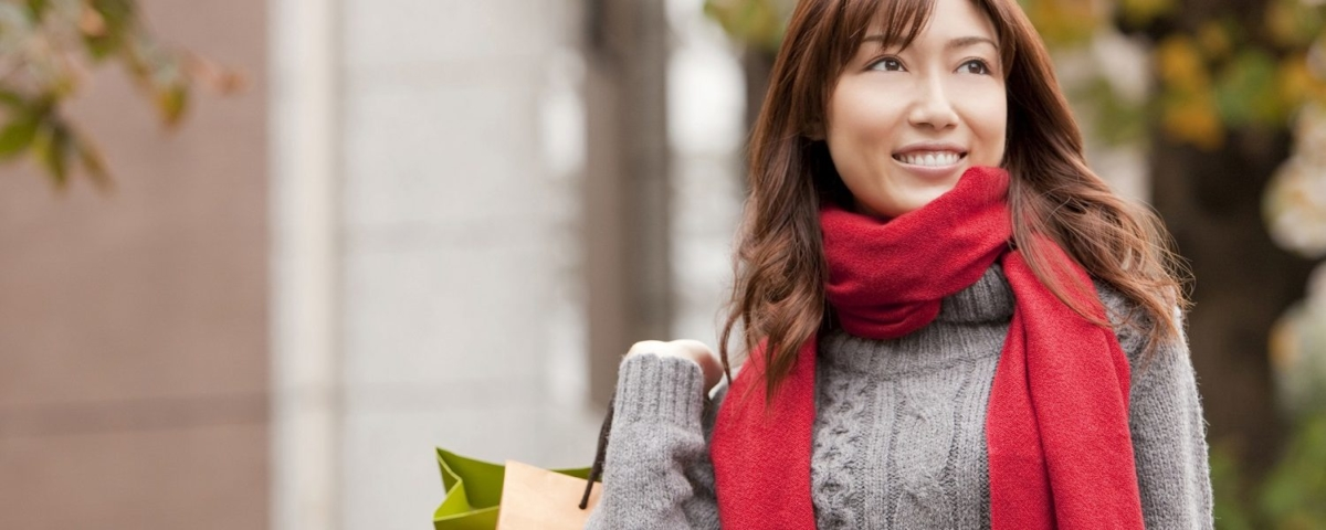 Woman with sweater and scarf.