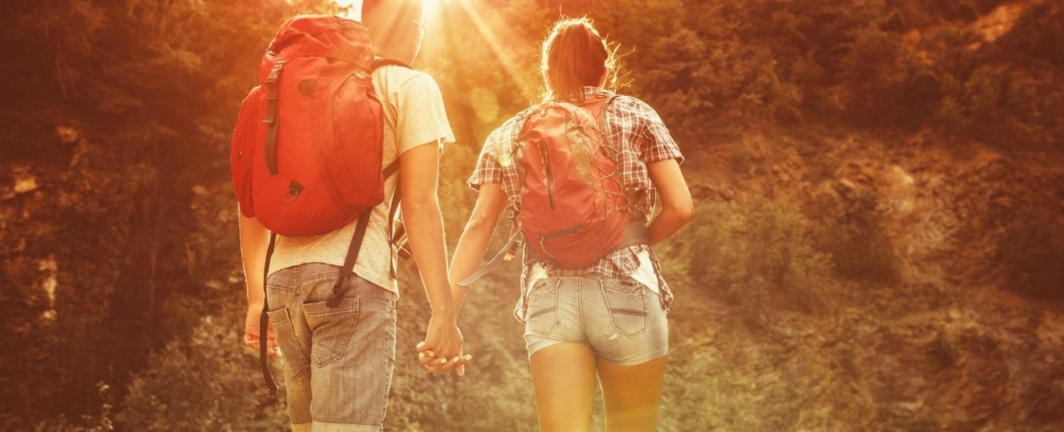 Hiking couple holding hands.