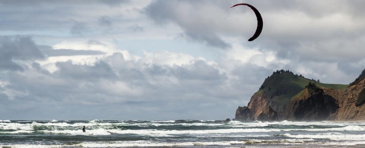 Kitesurfer on the coastal waves.