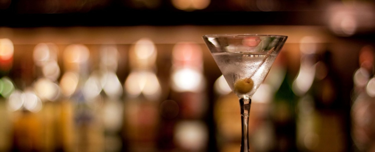 Close up of a martini with an olive.