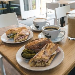 Two sandwiches and coffees.