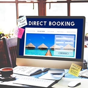 Stock photo of computer monitor. Text: Direct Booking.