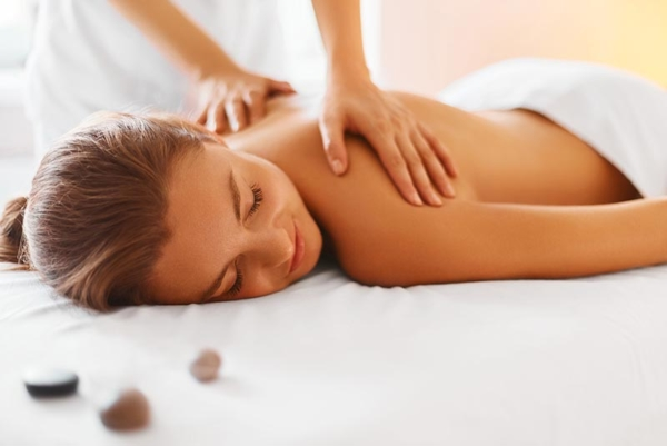 Woman getting back massage.