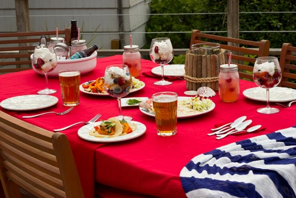 patio table with beer and food.