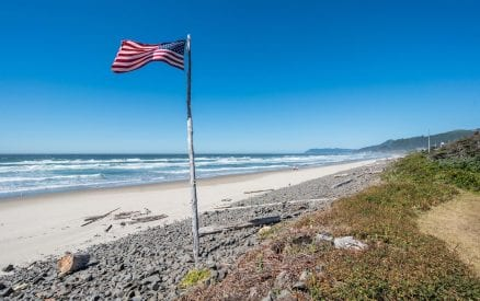 American Flag flying on the coast.