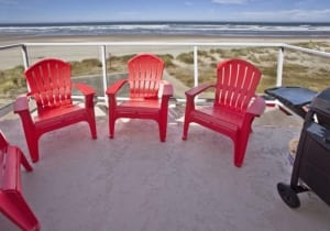 Coastal patio with Adirondack chairs.