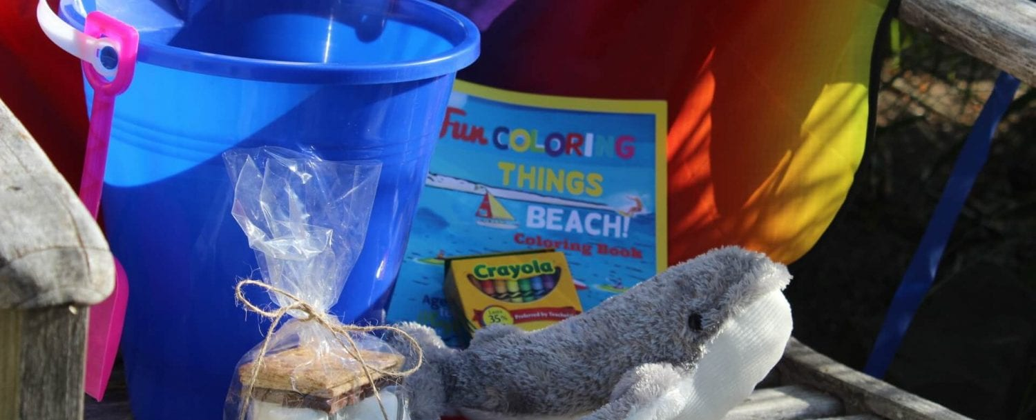 Kids club kit: bucket, whale toy, smores, coloring book.