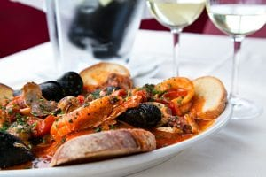 mediterranean seafood dish with wine