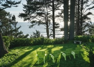 Purcell House - backyard with Adirondack chairs facing the ocean.