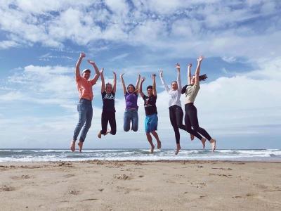 Group jumping at the beach.