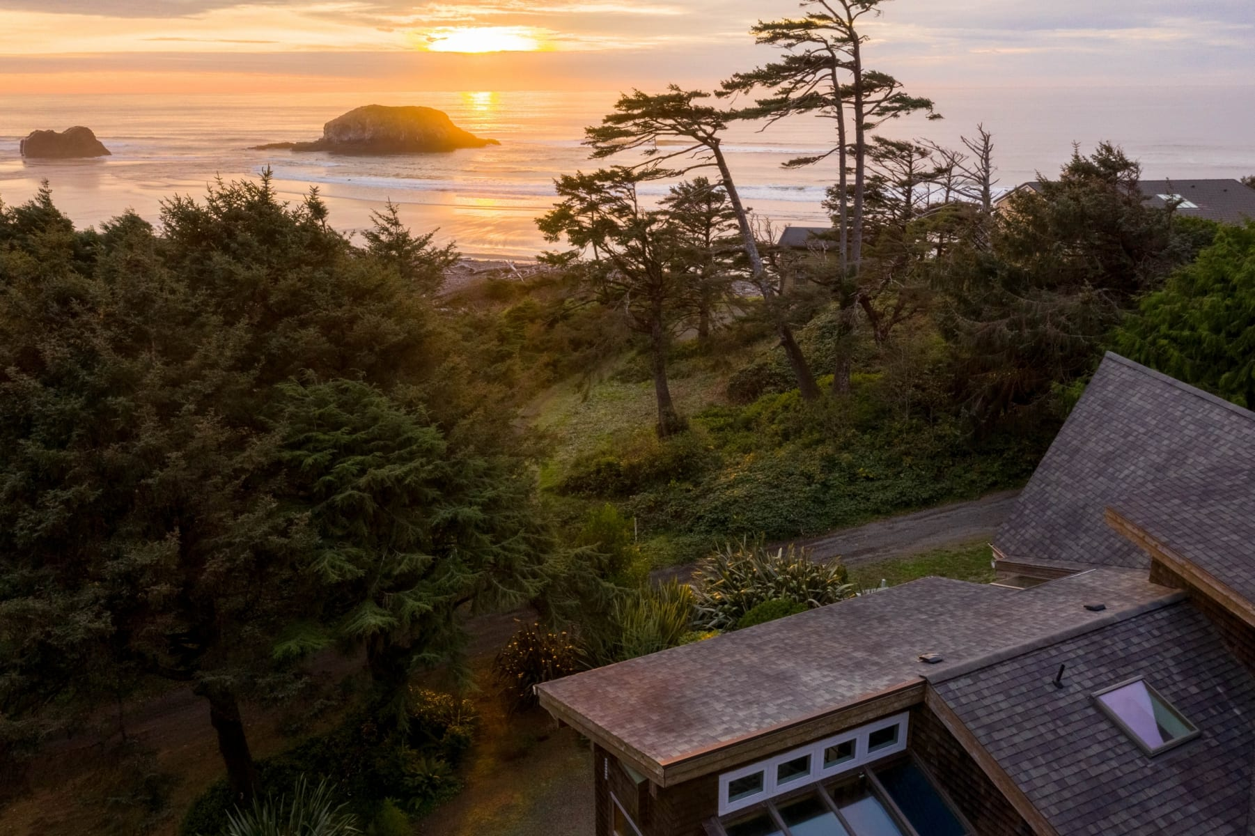 Overhead view of home and Oregon coast.