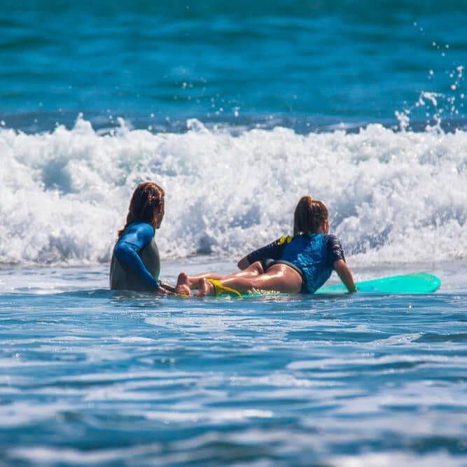 Photo of a Girl Enjoying Surf Lessons in Oregon.