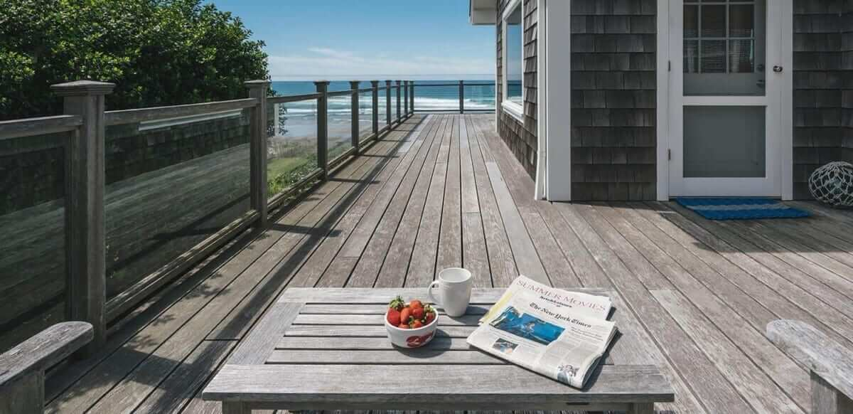 Vacation home deck with newspaper.