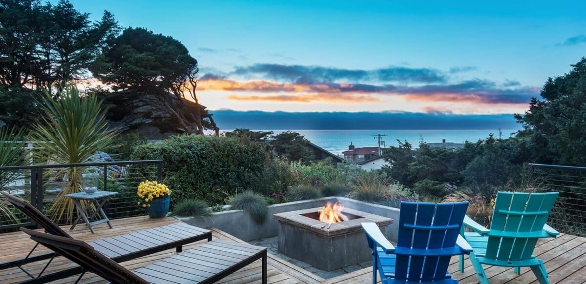 Deck chairs and firepit with coat vista.
